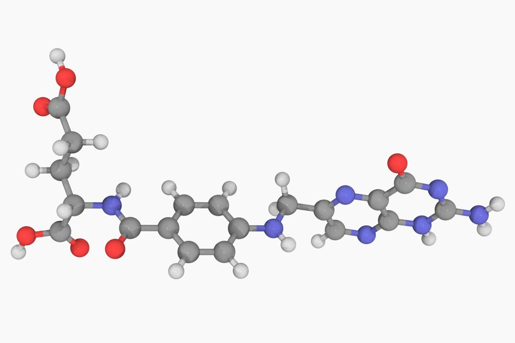 Folic acid (vitamin B9), molecular model. Atoms are represented as spheres and are colour-coded: carbon (grey), hydrogen (white), nitrogen (blue) and oxygen (red). (Laguna Design/Getty Images)