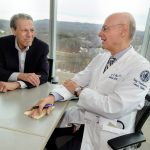 Lung cancer patient Michel Gueret, left, with his oncologist at UConn Health, Dr. Jeffrey Wasser. (Janine Gelineau/UConn Health Photo)