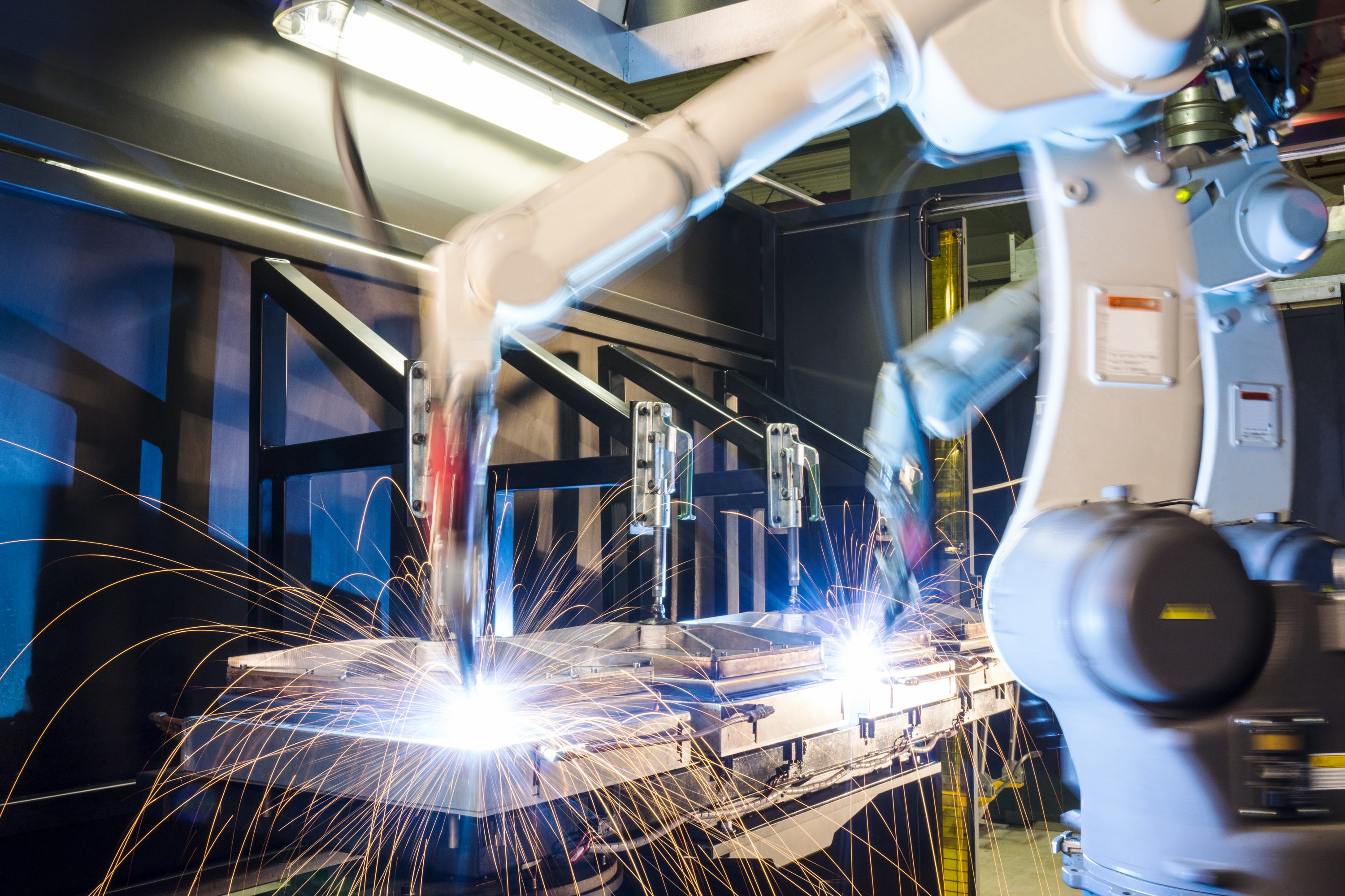 High-tech, industrial robotic welding machines in operation. (Getty Images)