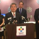 Dr. Ching Lau speaks at a press event to announce the 'Smash Childhood Cancer' global crowdsourcing research initiative. From left, Juan Hindo of IBM, Gov. Dannel P. Malloy, and Dr. Jim Shmerling, CEO of the Connecticut Children's Medical Center. (Lauren Woods/UConn Health Photo)