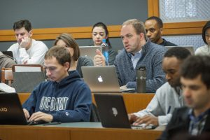 Listening to a lecture by Timothy Everett at UConn School of Law. (Sean Flynn/UConn Photo)