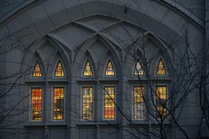 Glowing interior lights at dusk at the UConn School of Law. (Sean Flynn/UConn Photo)