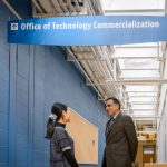 Mostafa Analoui, executive director of venture development., right, speaks with Ying Liu of ReinEsse LLC at the Cell and Genome Sciences Building in Farmington on Feb. 8, 2017. (Peter Morenus/UConn Photo)