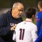 Men's soccer head coach Ray Reid speaks with Adria Beso Marco. (File Photo by Stephen Slade '89 (SFA) for UConn)