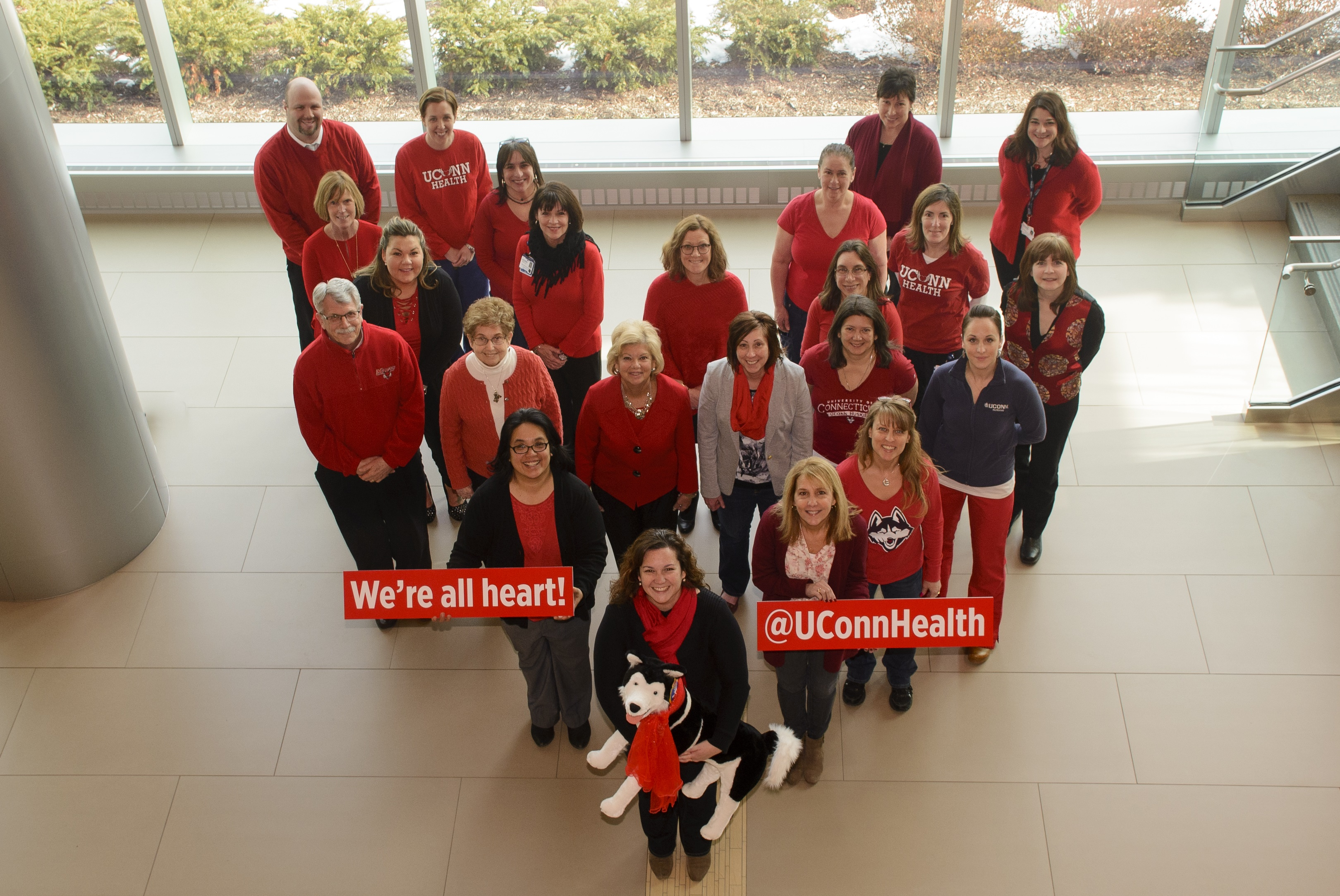 Staff gathered in the lobby of UConn John Dempsey Hospital's new tower to show how they Go Red for Women's heart disease awareness and prevention (Photo: UConn Health/Janine Gelineau).