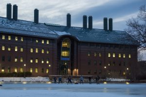 Students play ice hockey at Swan Lake, against the backdrop of the Chemistry Building, on Feb. 2, 2017. (Ryan Glista/UConn Photo)