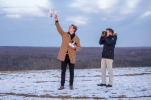 Fritz Bacon, left, operates a drone, while Scott Washburn of the UConn Photo Club takes a picture on Feb. 2, 2017. (Ryan Glista/UConn Photo)