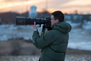 Jason Jiang of the UConn Photo Club takes photos on Horsebarn Hill on Feb. 2, 2017. (Ryan Glista/UConn Photo)