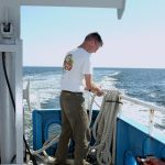 Nate Miller, a crew member of the RV Connecticut, attends to the cores that keep the Marine Sciences research vessel on track. (UConn File Photo)
