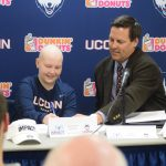 Ten-year old Genevieve Neiman, who has leukemia, joined the women's tennis program with her signing of a Husky Letter of Intent. (Athletic Communications/UConn Photo)