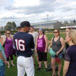 """Head baseball coach Jim Penders '94 (CLAS), '98 MA, speaks with undergraduate and graduate music students who performed in """"H.M.S. Pinafore"""" following the Huskies' win over Cincinnati on April 30. (Kenneth Best/UConn Photo)"""