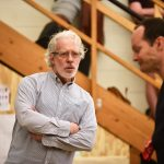 """Terrence Mann, artistic director of the Connecticut Repertory Theatre Nutmeg Summer Series, leads a rehearsal of """"1776"""" at the Drama-Music Building. (Peter Morenus/UConn Photo)"""
