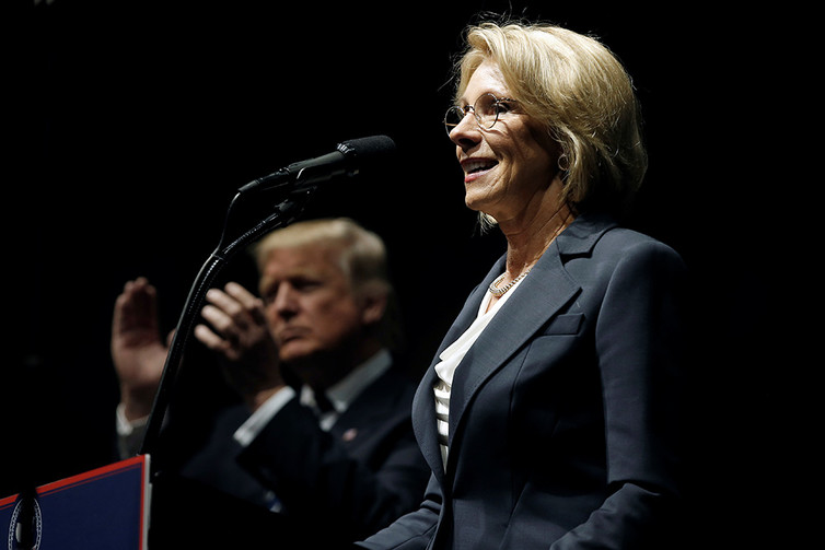 Secretary DeVos and President Trump want to put more money toward 'school choice,' but less in CTE and other areas that evidence shows bolster the economy. (Reuters/Mike Segar, via The Conversation)