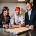 MBA student Shirley Tarabochia (left), JohnDePuma (center), founder of a gluten-free pasta business, and Wayne Bragg, instructor-in-residence in the School of Business. Tarabochia helped DePuma upgrade his business practices. (UConn School of Business Photo)