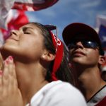 Puerto Rican citizen gestures during political rally in 2012. AP/Ricardo Arduengo