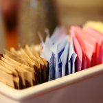 Close-Up Of Sugar And Sweetener Packets In Container At Cafe (Photo by Sharon Pruitt/EyeEm via Getty Images)