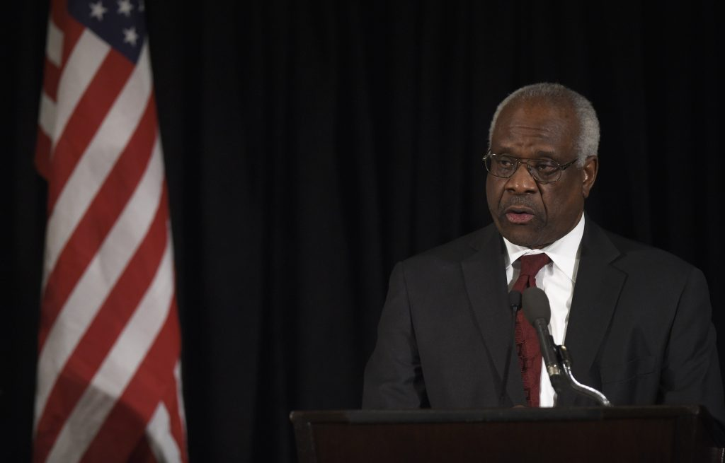 Supreme Court Justice Clarence Thomas speaks at the memorial service for former Supreme Court Justice Antonin Scalia in March 2016. (Photo by Susan Walsh-Pool/Getty Images)