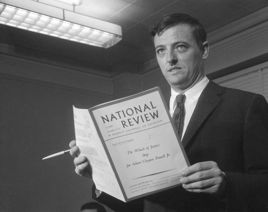 Magazine editor William F. Buckley Jr., editor of the National Review, holds a copy of the magazine as he makes a statement on the steps of the U.S. Courthouse. On the cover is the title of an article the magazine published, 'The Wheels of Justice Stop for Adam Clayton Powell, Jr.' Buckley, who admitted sending copies of the article to grand jury members investigating Powell, is facing charges of using improper influence on the jury. (Getty Images)