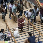 University students on a busy stairway. (Getty Images)
