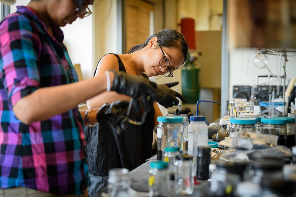 Chan Vy, right, a graduate student in materials science, and Chinthani Liyanage, a graduate student in chemistry, work with graphene in the lab at the Institute of Materials Science on Aug. 23, 2017. (Peter Morenus/UConn Photo)