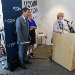 State Senator Cathy Osten, right, speaks about the state budget at the Avery Point campus student center on Sept. 25, 2017. Frome left are State Rep. Chris Soto, Gov. Dannel Malloy and President Susan Herbst. (Peter Morenus/UConn Photo)
