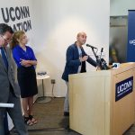 State Rep. Chris Soto, right, talks about budget cuts to the University at the Avery Point campus student center on Sept. 25, 2017.  At left are Gov. Dannel Malloy and President Susan Herbst. (Peter Morenus/UConn Photo)