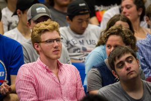 Nathan Berardi '21 (ENG) of Griswold, Connecticut, listens to members of the congressional delegation discuss the benefits of the new undersea engineering concentration. (Christopher LaRosa/UConn Photo)