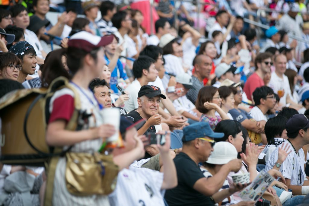 Human development and family studies professor Steven Wisensale, center, watches a baseball game at Chiba Marine Stadium near Tokyo. He spent the spring semester in Japan as a Fulbright Scholar. (Chris Moore for UConn)