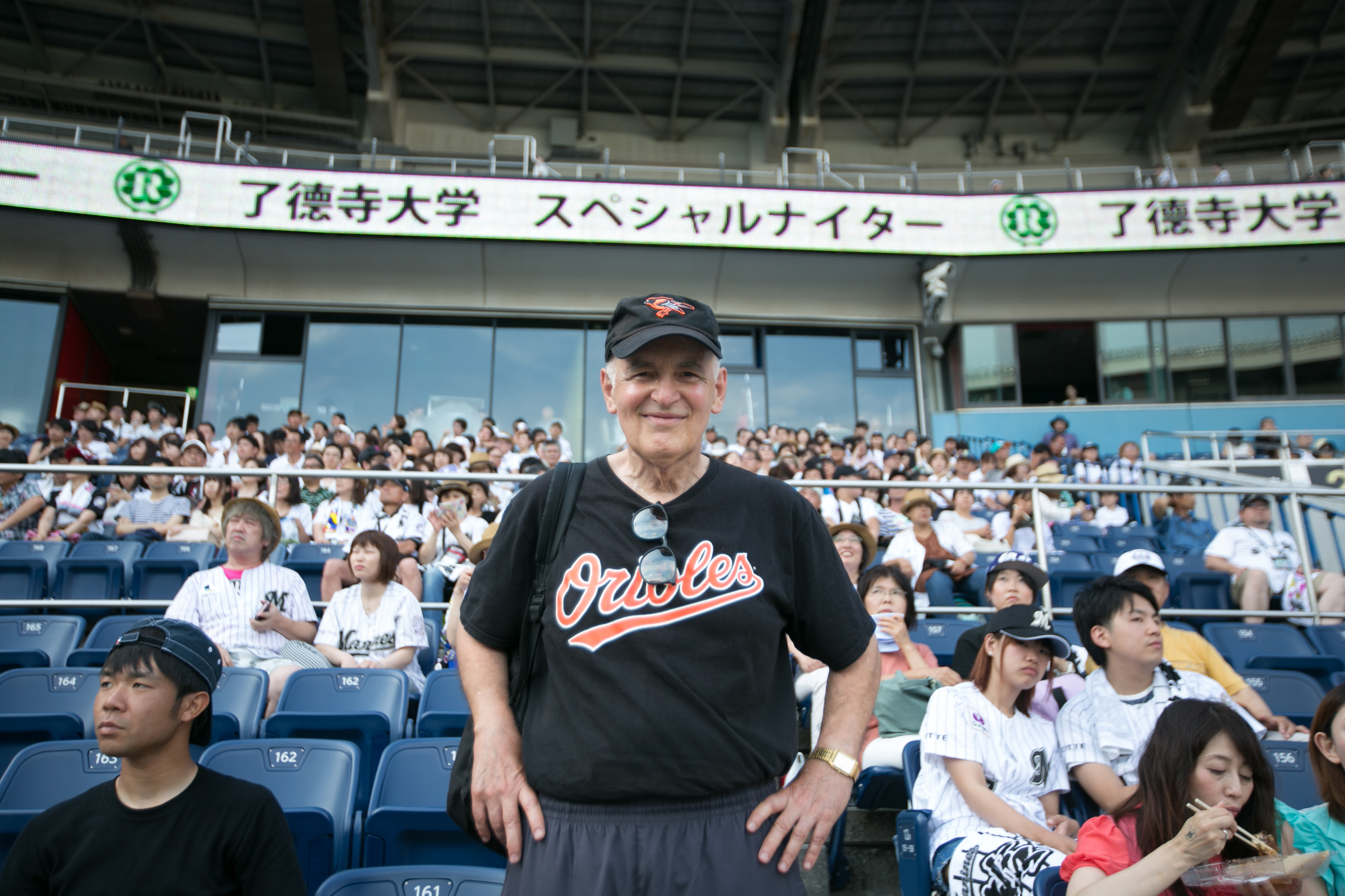 Steven Wisensale, professor of human development and family studies, watches a baseball game in Japan. (Chris Moore for UConn)