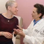 Cancer specialist Dr. Susan Tannenbaum with patient Elizabeth Johnston at UConn Health's Carole and Ray Neag Comprehensive Cancer Center. (Janine Gelineau/UConn Health Photo)
