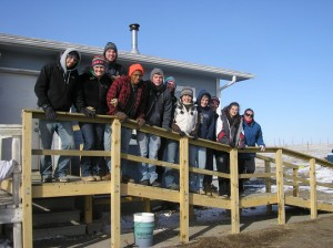 A group of students on a wheelchair ramp they constructed at Arlene High Horse's house on Pine Ridge Indian Reservation in South Dakota during spring break. Photo by Lauren Young