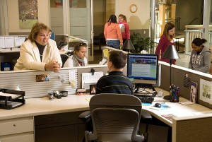 <p>Director Donna Korbel, left, chats with students in the Center for Students with Disabilities in the Wilbur Cross Building. Photo by Frank Dahlmeyer  </p>