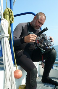 <p>Diving safety officer Jeffrey Godfrey prepares an underwater camera for a dive. Photos supplied by Jeffrey Godfrey</p>
