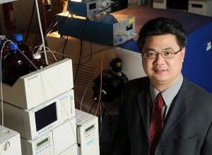 <p>Xudong Yao, assistant professor of chemistry, in his lab. Photo by Peter Morenus </p>