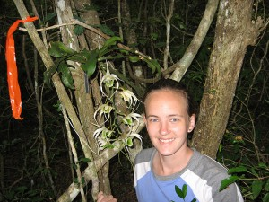 <p>Kathryn Theiss, a Ph.D. student in ecology and evolutionary biology, with an orchid in Madagascar. Photo supplied by Kathryn Theiss</p>