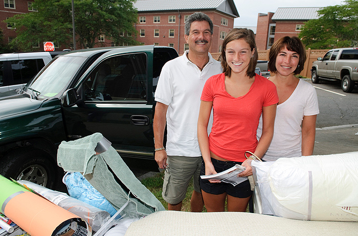 <p>Alexa Brancato, a freshman, with her parents Jim and Donna Brancato of Guilford outside the North Campus Residence Halls. Photo by Peter Morenus</p>