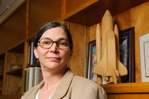<p>Mary Musgrave, professor of plant physiology, with a model of the space shuttle in her office.  Photo by Peter Morenus</p>
