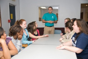 Miguel Colon, a program coordinator in Student Activities, leads a meeting of students in the Community Service living-learning community in Ellsworth residence hall. Photo by Jessica Tommaselli