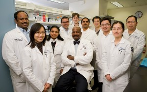 <p>Dr. Cato T. Laurencin, center, vice president for health affairs and dean of the medical school, with a team of researchers for whom he serves as a mentor. Photo by Lanny Nagler</p>