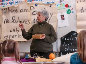 <p>Davyne Verstandig teaches poetry to first and second graders at Kent Center elementary school. Photo by Linda Miller</p>