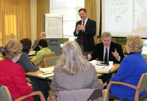 <p>Richard Lemons, assistant professor of educational leadership and director of the Institute for Urban School Improvement, conducts a leadership training session for school superintendents. Photo by Janice Palmer</p>