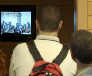 <p>Students watch CNN footage of the World Trade Center attack on Sept. 11, 2001 on a television at the Homer Babbidge Library. Archival photo by Peter Morenus</p>