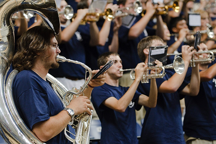 <p>The UConn Marching Band performs at the Convocation ceremony at Gampel Pavilion. Photo by Peter Morenus</p>
