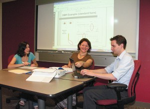 <p>Sandra Chafouleas, center, associate professor of educational psychology, speaks with members of her Direct Behavior Ratings research team, including Rose Jaffery, a graduate assistant, left, and Jamison Judd, Neag School webmaster. Photo by Janice Palmer</p>