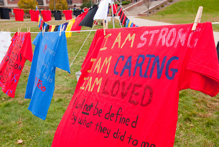 <p>T-shirts decorated by sexual assault survivors or their friends are displayed on the South Green as part of 'The Clothesline Project' during Domestic Violence Awareness Week. Photo by Frank Dahlmeyer</p>
