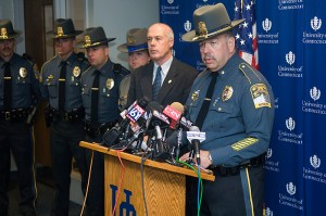 <p>Maj. Ronald Blicher of the UConn Police Department at the podium, and, second from right, Commissioner John A. Danaher III of the state Department of Public Safety. Photo by Daniel Buttrey</p>