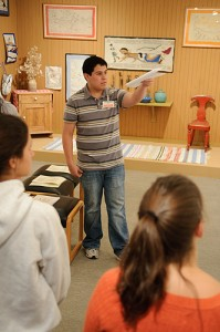 <p>Docent Kevin Solorzano, a sophomore, leads a tour of the William Benton Museum of Art. Photo by Peter Morenus</p>