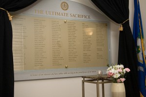 <p>The Roll of Honor at the Alumni Center contains the names of those UConn students and alumni who died in the service of their country. Photo by Tom Hurlbut</p>