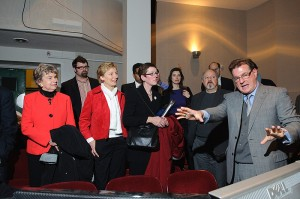 <p>Tim Hunter, professor of dramatic arts, right, explains the technology behind the CRT production of Galileo to legislators and representatives of Blue Sky Studios. Front row from left are Reps. Joan Lewis and Pam Sawyer, and Maryann Hanley and Rob Keating of the Office of Workforce Competitiveness. Photo by Peter Morenus</p>