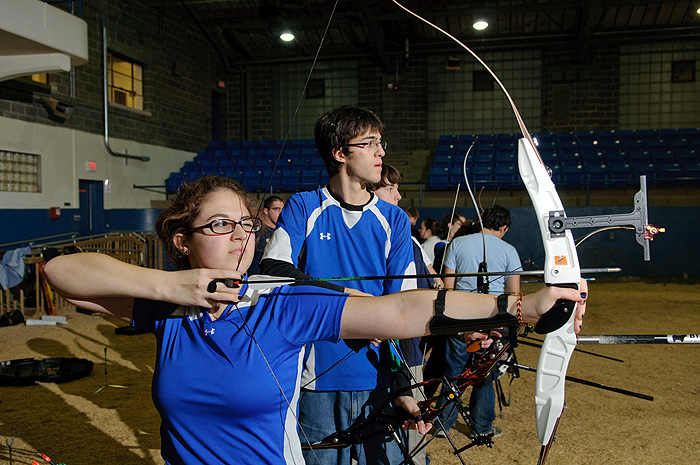 <p>Members of the Archery club Rachel Hyland, foreground, a freshman, and Sam Hopkins, a sophomore, practice at Ratcliffe Hicks Arena. Photo by Peter Morenus</p>
